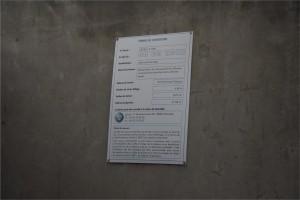 Annonce du permis de construire, sur le gymnase de la Rampe. (photo : BB, Le Crieur de la Villeneuve)